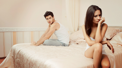 unhappy-young-couple-sitting-o-7540-9943