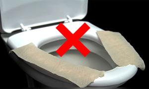 Lý do không nên lót giấy lên bồn cầu khi đi vệ sinh