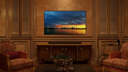 Phòng khách có tông màu ấm áp với chất liệu gỗ là chủ đạo, được phối thêm hai màu kinh điển là xanh cỏ úa và đỏ crimson, điểm xuyết chút vàng quý phái từ bộ sưu tập gương và khung tranh hay một vài món đồ gốm Á đông nhẹ nhàng.