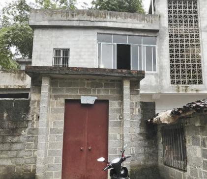 Ngôi nhà nơi cậu bé được tìm thấy bên thi hài ông nội. Ảnh:Nanguo Morning Post.