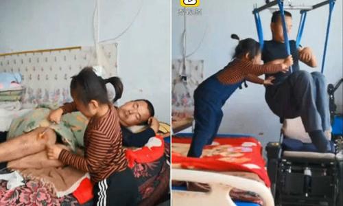 Bé gái 6 tuổi kiếm tiền nuôi cha bị liệt từ những video trực tuyến