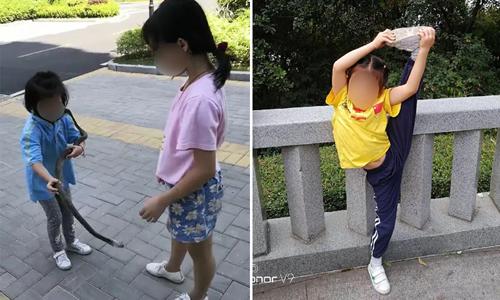 Con gái của anh Huang chế ngự rắn và luyện võ từ nhỏ. Ảnh: Sina.