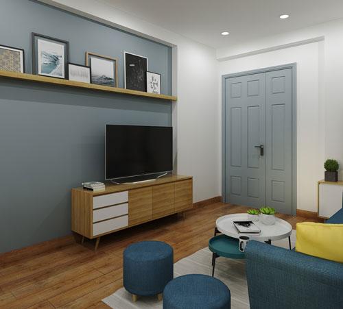 Kệ treo tường được trang trí những khung ảnh nhỏ xinh, hài hòa với màu sắc chung tổng thể của ngôi nhà.