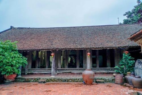 Nhà ông Toàn với kiến trúc 5 gian, 2 chái, vẫn giữ được nguyên bản với niên đại 401 năm. Ảnh: Trọng Nghĩa.