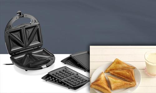 Máy làm bánh 3 trong 1 Tiross: giá gốc 890.000 đồng, giảm còn 599.000 đồng.Lớp khuôn tráng lớp chống dính, nên bánh không bị cháy đen, giúp việc vệ sinh đơn giản hơn. Máy có 3 loại vỉ nướng đi kèm. Bạn có thể làm các loại bánh như sandwich, waffle, bánh quy, bánh trứng; hay nướng thức ăn trực tiếp trên vỉ. Bạn có thể kẹp sandwich với bơ, pate, thịt, trứng, mứt quả... và bỏ vào máy. Sau 1 - 2 phút, phần vỏ bánh được nướng giòn, nhân bên trong vừa chín tới tạo vị thơm ngon. Để bảo vệ lớp chống dính, khi lấy bánh ra khỏi máy không sử dụng vật bằng kim loại.