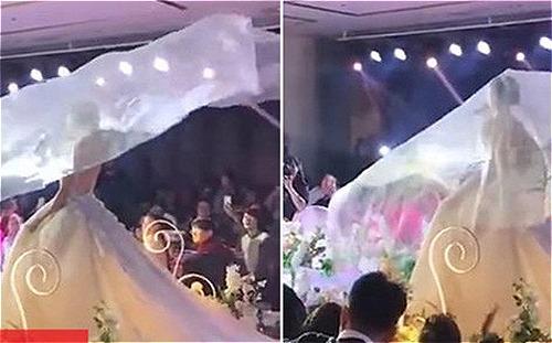 Chiếc khăn voan biết bay là trào lưu mới nổi trong các đám cưới ở Trung Quốc. Ảnh: Xuehua.