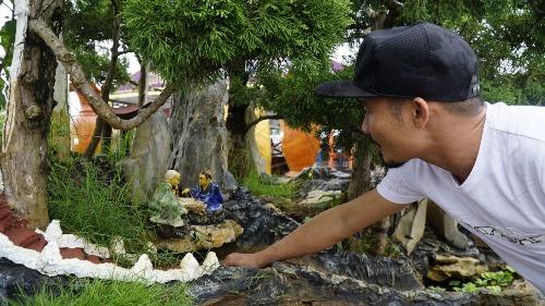 Phong thủy của tác phẩm là yếu tố quan trọng nhất mà chủ nhân chậu cây muốn gửi gắm. Ảnh:Trọng Nghĩa.