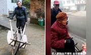 Con trai 70 dùng xe cút kít đẩy mẹ 90 tuổi tới bệnh viện