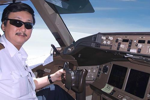 Cơ trưởng Nguyễn Nam Liên trên một chuyến bay. Ảnh: NL