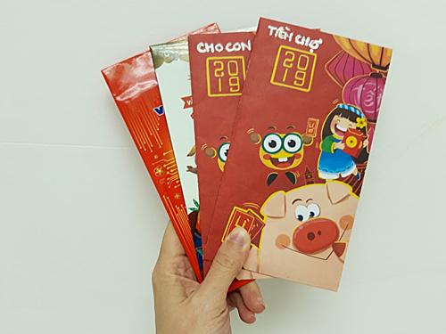 Trước khi khởi động kế hoạch chia tiền tiêu dùng thành 4 phong bì, chị Quỳnh Anh đã cho vào mỗi phong bì một ít tiền để có động lực. Ảnh: Quỳnh Anh.