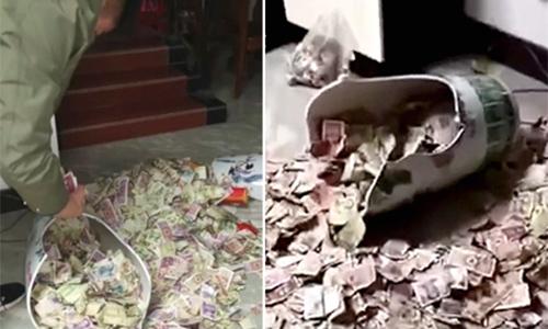 Ông bố giấu tiền trong chiếc bình suốt 13 năm. Ảnh: Press China.