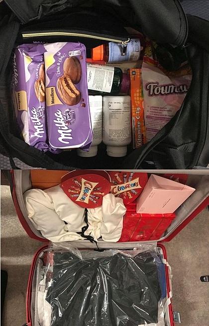 Hai vali quà của chị Trang bao gồm kẹo bánh, mỹ phẩm, rượu. Ảnh: NVCC.