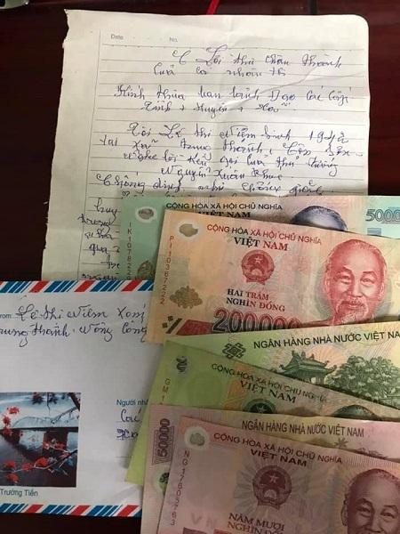 Số tiền một triệu đồng và lá thư bà Niệm gửi chính quyền để ủng hộ phòng, chống Covid-19. Ảnh: Gia Xuân.