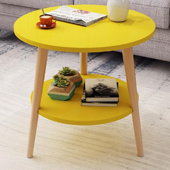 Bàn trà sofa 2 tầng chân tròn 605.000đ 378.000đ (-38%) làm từ chất liệu gỗ MDF phủ melamin, Mặt bàn rộng 50cm, cao 49cm  Thiết kế 3 chân mang lại cảm giác sang trọng và hiện đại cho không gian của bạn.  - Thiết kế hai tầng cho phép bạn để được nhiều món đồ yêu thích như quyển sách, bộ ấm trà, lọ hoa hay những đồ trang trí nhỏ bé.  - Mặt bàn được dán cạnh, giảm bớt lo ngại về va chạm trong quá trình sử dụng.  - Bạn có thể đặt chúng ở nhiều vị trí như phòng khách, phòng ngủ hay ban công.  Các màu có sẵn cho bạn lựa chọn:  - Trắng tinh khiết tô lên sự trẻ trung, sang trọng của không gian.  - Vàng khơi gợi cảm hứng sáng tạo và mang đến một phong cách sống sôi động.