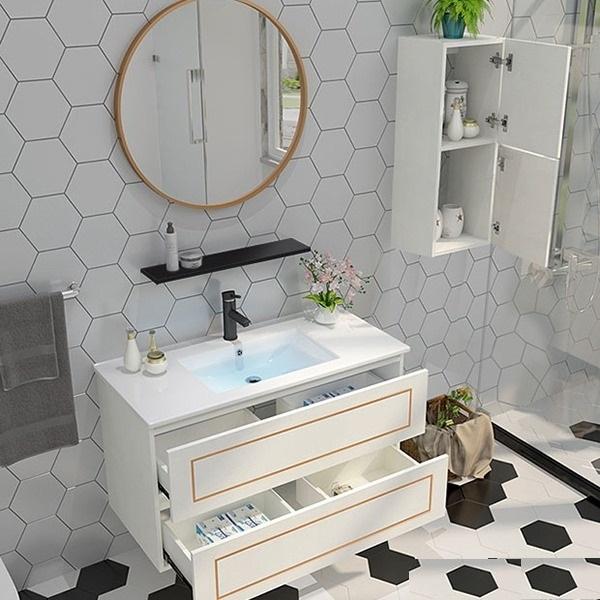 Bộ tủ, chậu, kệ gương Lavabo ZT-LV893 đang có giá ưu đãi 34% trên Shop VnExpress, giảm còn 5,25 triệu đồng. Thiết kế gương tròn giúp tạo điểm nhấn mới lạ cho không gian phòng tắm nhà bạn. Hai ngăn tủ rộng rãi bên dưới dùng cất giữ khăn tắm, các vật dụng cá nhân ngăn nắp, gọn gàng, tránh bị thấm nước. Bề mặt kệ và lavabo sáng bóng, chống nước và mối mọt tốt.