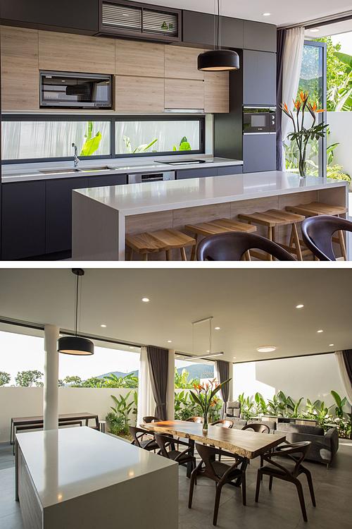 Bếp được đặt ở sau nhà, nhìn ra vườn. Ảnh: 85 Design.