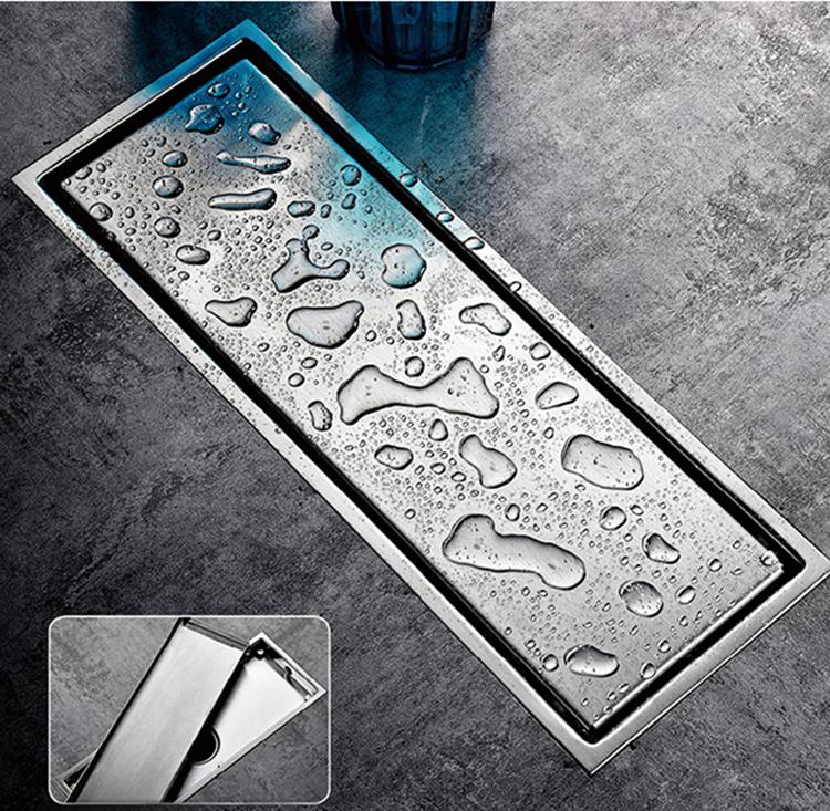 Thoát sàn Zento ZT553-2U làm từ inox có kích thước 11 x 30 cm, phần ống xả 2 lớp có cấu tạo vừa giúp thoát nước nhanh chóng vừa chống mùi hôi từ đường ống và các loại côn trùng có thể xông lên. Nắp của phễu thoát sàn có thiết kế 1 mặt, có thể cắt gạch ốp vào bên trong, giúp che đi phần thu nước, tạo tính thẩm mỹ cho không gian. Thoát sàn phù hợp với đường ống có đường kính từ 70 đến 85mm. Sản phẩm đang được bán ưu đãi với giá 490.000 đồng bảo hành 12 tháng.