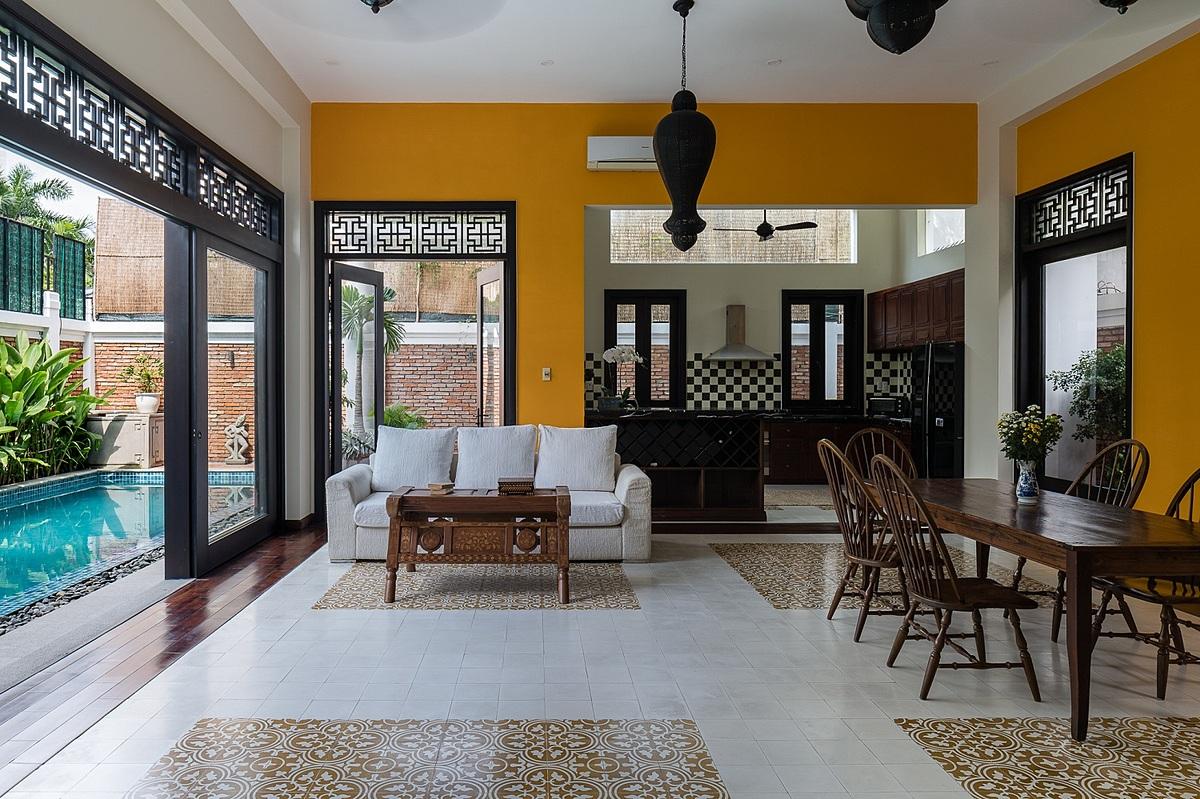 Không gian sinh hoạt chung của gia đình gồm phòng khách, bếp và phòng ăn nối liền. Ảnh: Quang Trần.