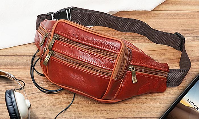Túi đeo chéo da bò Manzo TDH2.V làm từ da bò, hạn chế bong tróc, trày xước. Kích thước 20 x 18 x 8 cm, có nhiều ngăn, phù hợp để đựng nhiều món đồ, từ điện thoại tới tai nghe, thẻ... Là một món phụ kiện thời trang hữu ích, sản phẩm có hai màu đen hoặc đỏ, đang được bán với giá 139.000 đồng.