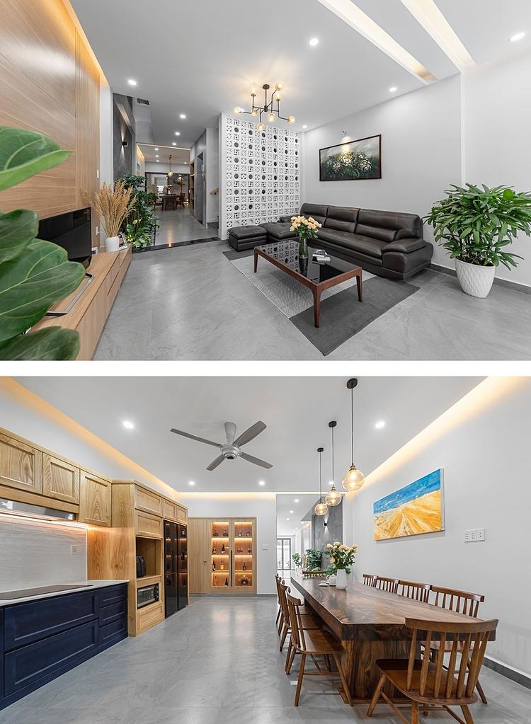Tầng trệt dành cho không gian sinh hoạt chung gồm phòng khách và bếp - phòng ăn. Hai khu vực này được ngăn cách bởi cầu thang bộ và thang máy ở giữa. Ảnh: Goku.
