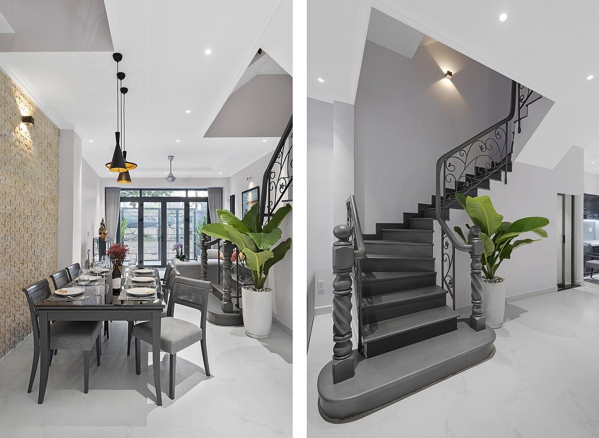 Nội thất gỗ và cầu thang cũ được sơn lớp áo mới để phù hợp với không gian nhà sau cải tạo. Ảnh: Goku.