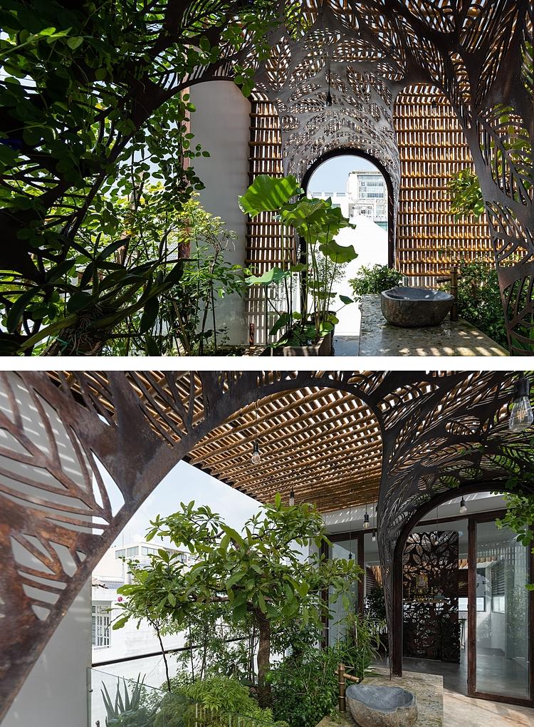 Khu vườn trên sân thượng với mái tre và vòm sắt. Ảnh: Quang Dam.