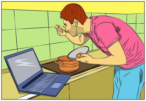 Vì sao không nên ăn khi ngồi trước máy tính