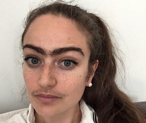 Eldina có ngoại hình khác biệt vì không tỉa lông mày hay cạo ria mép như phụ nữ Đan Mạch khác. Ảnh: Metro.
