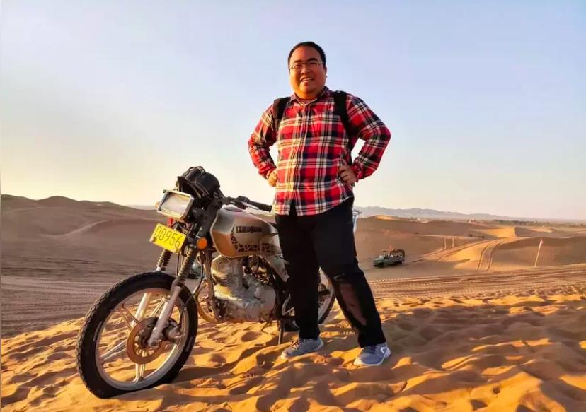 Zhang với bức hình đăng lên mạng kiếm vợ bị chê về ngoại hình. Ảnh: Globaltimes.
