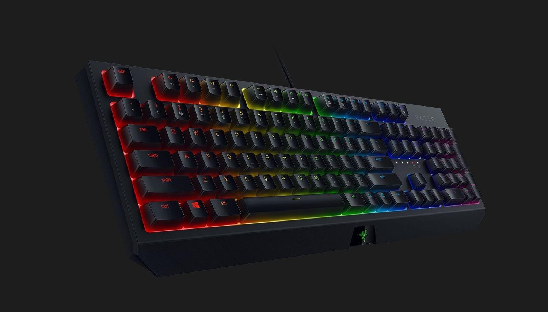 Với các game thủ, ngoài chuột và tai nghe chắc chắn không thể thiếu bàn phím cơ đi kèm. Bàn phím Razer BlackWidow Mechanical Gaming Keyboard RZ03-02860100-R3M1 với thiết kế đen tuyền đặc trưng kèm logo Razer nổi bật, cá tính, góc cạnh. Led 7 màu có thể điều chỉnh tùy ý, giúp khu vực chơi game thêm bắt mắt, sống động. Sản phẩm có giá giảm 16% còn 2,869 triệu đồng (giá gốc đến 3,399 triệu đồng).