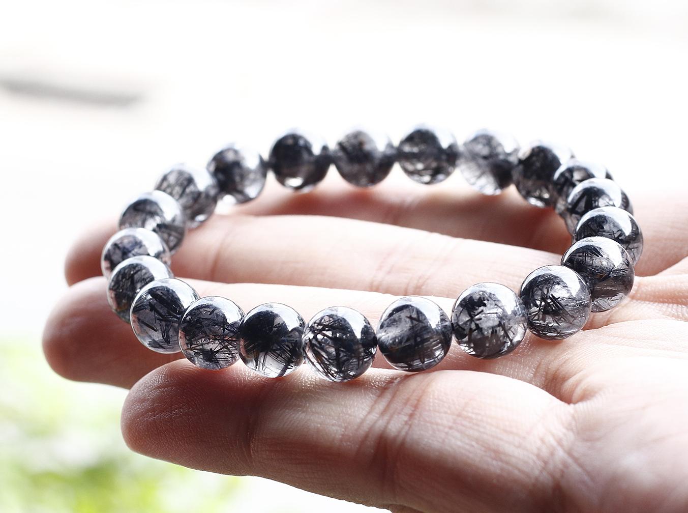 Vòng đá thạch anh tóc đen hạt trong nhiều tóc 8 mm Ngọc Qúy Gemstones giảm 38% còn 839.000 đồng; bảo hành 24 tháng.