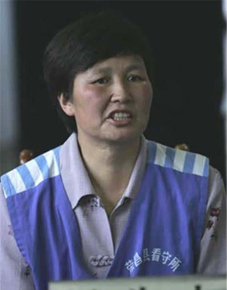 Hồng Tú Đào tại tòa sau 11 năm bị bắt cóc, phải sống trên núi. Ảnh: qq.